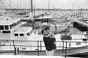 John Wayne aboard his yacht Wild Goose with his son Ethan circa 1966 © 1978 Gunther - Image 0898_3389