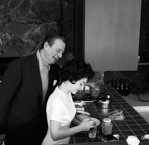 John Wayne and his wife Pilar at home on Louise Street in Encino, California 1958 © 1978 Bernie Abramson - Image 0898_3402