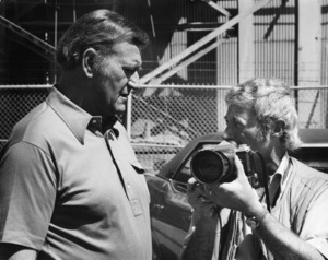 "John Wayne and photographer David Sutton on the set of ""McQ""1974 © 1978 David Sutton - Image 0898_3426"