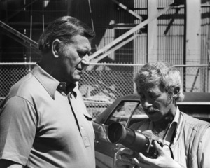 "John Wayne and photographer David Sutton on the set of ""McQ""1974 © 1978 David Sutton - Image 0898_3427"