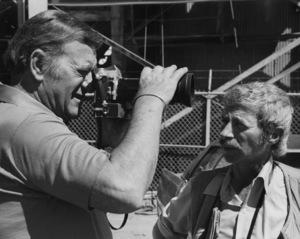 "John Wayne and photographer David Sutton on the set of ""McQ""1974 © 1978 David Sutton - Image 0898_3428"