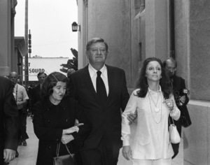 John Wayne with his wife, Pilar, at director John Ford