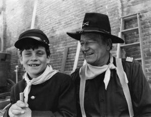 "John Wayne and his son, Ethan, during the making of ""Rio Lobo""1970© 1978 David Sutton - Image 0898_3464"