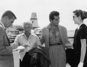 Cheryl Crane chats with smiling Johnny Stompanato and her mother, Lana Turner, when they returned to Los Angeles from a vacation in Acapulco, Mexico.  An unidentified reporter interviewed the star.04-05-1958 - Image 0954_0717