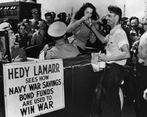 Hedy Lamarr with shipfitter Richard Spencer, as she tries to boost War Savings Bond sales by touring the Philadelphia Navy Yard in Pennsylvaniacirca 1940s - Image 0958_0124