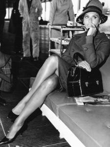 "Sophia Loren waiting for a flight to Frankfurt, Germany, where she received the ""Bambi"" AwardApril 1961 - Image 0959_2076"