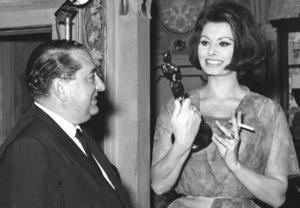 Sophia Loren shows Joseph Levine her Oscar in herhome in Rome, Italy, c. 1961 - Image 0959_2092