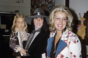 Cher, holding her daughter Chastity Bono, with her mothercirca 1970s © 1978 Gary Lewis - Image 0967_0264