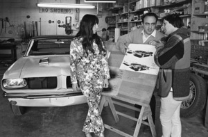 Sonny and Cher Bono, with George Barris, going over the designs for their identical Ford Mustangs1967© 1978 Marv Newton - Image 0967_0281