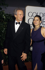 "Clint Eastwood and Dina Ruiz at ""The 53rd Annual Golden Globe Awards""1996© 1996 Gary Lewis - Image 0973_0915"