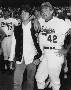 Gene Barry and his son Fred during a lull in the Stars vs. Broadcasters baseball game at Dodger Stadium in Los Angeles, CA1968Photo by Joe Shere - Image 10148_0003