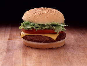 """Food Shots""Cheeseburger with Lettuce and Tomatocirca 1982 © 1982 Sid Avery - Image 10370_0678"