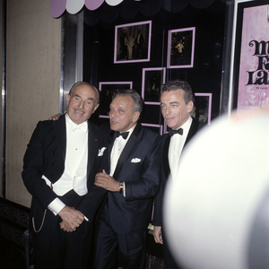 """Jack L. Warner, Frederick Loewe and Alan J. Lerner at the New York premiere of """"My Fair Lady"""" October 21, 1964Photo by Irv Steinberg** B.D.M. - Image 10706_0035"""