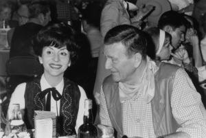"""Share Party""Pilar Wayne & John Wayne1965 © 1978 Kim Maydole Lynch - Image 10736_0008"