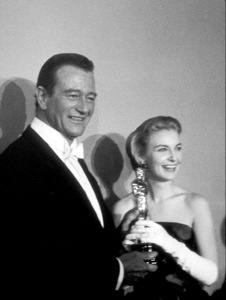 """Academy Awards: 30th Annual,"" John Wayne and Joanne Woodward. 1958. © 1978 Sid Avery - Image 10764_0006"