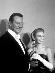 """Academy Awards: 30th Annual,"" John Wayne and Joanne Woodward. 1958. © 1978 Sid Avery - Image 10764_0006"
