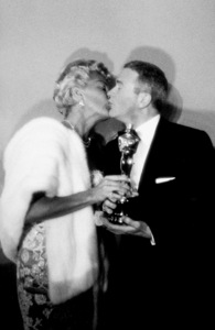 """""""Academy Awards: 30th Annual,"""" Lana Turner and Red Buttons. 1958. © 1978 Sid Avery - Image 10764_0017"""
