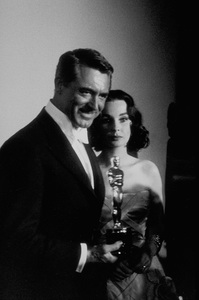 """""""Academy Awards: 30th Annual,"""" Cary Grant, Jean Simmons. 1958. © 1978 Sid Avery - Image 10764_0021"""