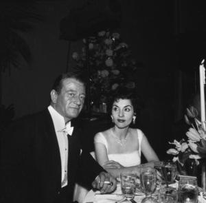 """Academy Awards - 30th Annual""John Wayne, Pilar Wayne1958 © 1978 Bernie Abramson - Image 10764_0077"
