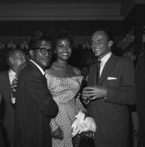 Sammy Davis Jr. and Frank Sinatra at a bon voyage party for Patsy and Rose D