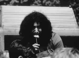 Jerry Garcia of the Grateful Dead smelling a flower in Seattle, 1967. © 1978 Ulvis AlbertsMPTV - Image 10777_1
