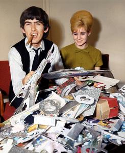 George Harrison reading fan mailand smoking a cigarc. 1963 London**I.V. - Image 10838_0113