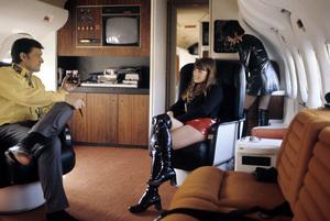 "Hugh Hefner on his private Playboy jet (the ""Big Bunny"") with Barbi Benton1970© 1978 Gunther - Image 10869_0002"