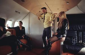 Hugh Hefner on his privatePlayboy jet, 1970 © 1978 Gunther - Image 10869_0004