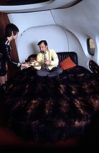Hugh Hefner on his privatePlayboy jet, 1970 © 1978 Gunther - Image 10869_0005
