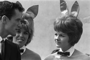 Hugh Hefner with a couple of Playboy Bunniescirca 1960s© 1978 Roy Cummings - Image 10869_0020