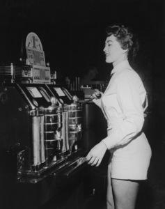 Girl playing slot machine at the Flamingo Hotel in Las Vegas 1955 © 1978 David Sutton - Image 10954_0019