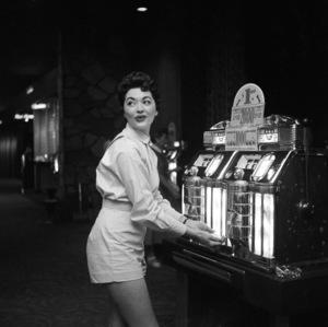 Girl playing slot machine at the Flamingo Hotel in Las Vegas1955 © 1978 David Sutton - Image 10954_0037
