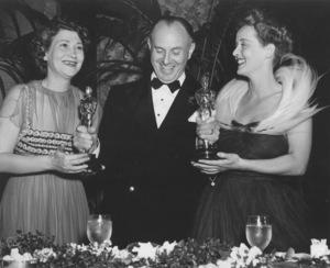"""Academy Awards: 11th Annual,"" Faye Bainter, Jack Warner, Bette Davis1939Photo by Schuyler Crail - Image 11134_0002"