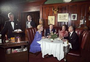 Maude Chasen dining at her restaurant, Chasen