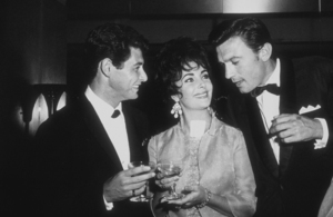 Eddie Fisher, Elizabeth Taylor and Laurence Harvey at a party thrown by Eddie Fisher at the Coconut GroveC. 1960 © 1978 David SuttonMPTV - Image 1147_0005