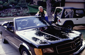 Jed Allan with his 1991 Mercedes convertible, 1991. © 1991 Gunther - Image 11536_1