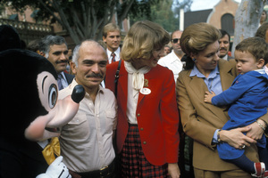 King Hussein of Jordan with his wife Queen Noor and son Prince Hamzah at Disneyland1982 © 1982 Gunther - Image 11561_0001