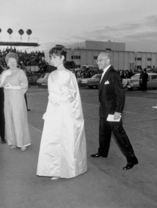 """""""Academy Awards: 37th Annual,""""Audrey Hepburn and George Cukorarrive for the award ceremony.  1965.Photo by Mel Traxel - Image 1185_0016"""