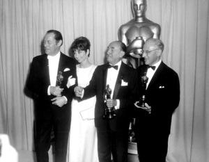 """Academy Awards: 37th Annual,""Rex Harrison, Audrey Hepburn, Jack Warner,George Cukor.  1965.Photo by Mel Traxel - Image 1185_0018"