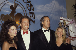 """Arnold Schwarzenegger and Maria Shriver with Chevy Chase and his wife Jayni at a """"Carousel of Hope Ball""""1990 © 1990 Gunther - Image 11937_0016"""