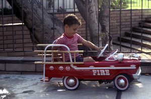 Kids CategoryRon Avery riding a Pedal Car1961 © 1978 Sid Avery - Image 12261_0017