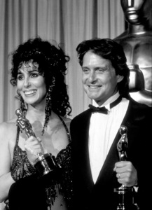 """""""Academy Awards: 60th Annual,"""" Cher (Best Actress) and Micahel Douglas (Best Actor). 1988. © 1988 Gunther - Image 12279_0008"""