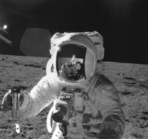 Astronaut Alan Bean holds special environmental sample container. Apollo 12, 1969. - Image 12355_0102