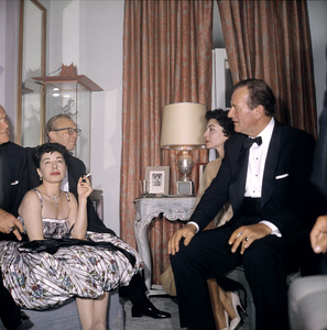 """Cobina Wright Party"" John Wayne with his wife Pilarcirca 1955 © 1978 Wallace Seawell - Image 12358_0021"