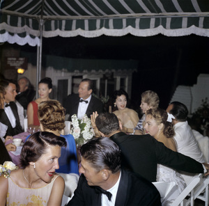 """Cobina Wright Party"" (foreground) Ronald Reagan, Nancy Reagan (background) John Wayne, Pilar Wayne, Zsa Zsa Gaborcirca 1955 © 1978 Wallace Seawell - Image 12358_0022"