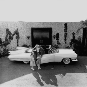 Clockwise: William Castle,Georgianna (niece), Marcia, Terry Ann, wife Ellen, and their 1959 Cadillac,1959. © 1978 Sid Avery MPTV - Image 124_5
