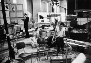 """""""The Benny Goodman Story"""" Recording Session, Universal 1955.Erbie Green (trombone) and Stan Getz (sax). © 1978 Bob Willoughby / MPTV - Image 13318_4"""