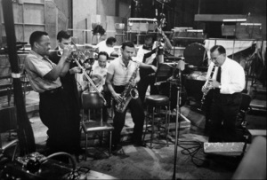 """The Benny Goodman Story"" Recording Session, Universal 1955.Buck Clayton (trumpet), Erbie Green (trombone), Gene Krupa (drums), Stan Getz (sax), and Benny Goodman (clarinet). © 1978 Bob Willoughby / MPTV - Image 13318_7"
