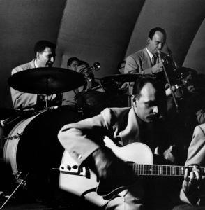 Stan Kenton Orchestra: Shelly Manne (drums), Maynard Ferguson (trumpet), Laurindo Almeida (guitar), and Milt Bernhart (trombone) in Balboa 1950 © 1978 Bob Willoughby - Image 13360_401