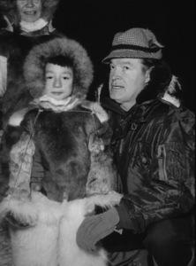 """U.S.O. Tour""(Alaska)Bob Hope in Fairbanks with an Eskimo family1956Photo By Gerald SmithMPTV - Image 13446_1"